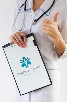 Woman holding clipboard and stethoscope