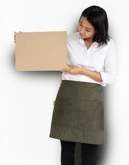 Woman holding cork board