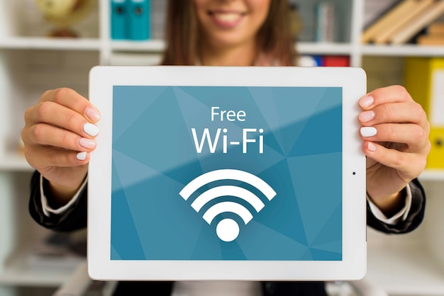 Woman holding digital tablet with free wi-fi lettering