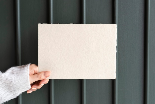 Woman holding a greeting card mockup