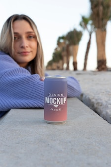 Woman holding a mock-up canned soda