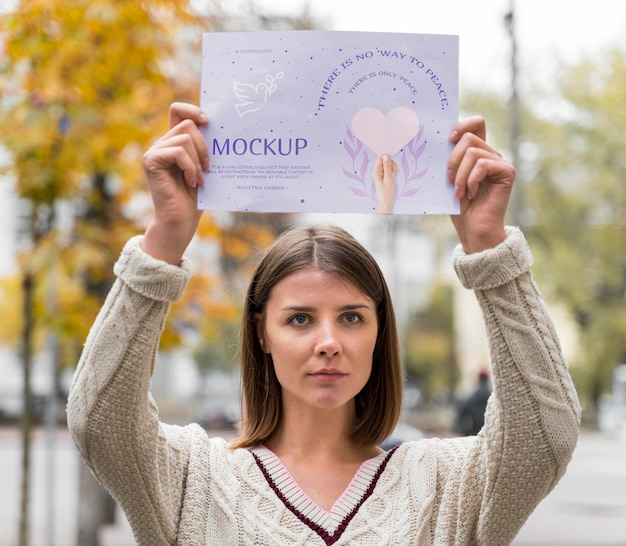 Woman holding a non violence day mock-up paper