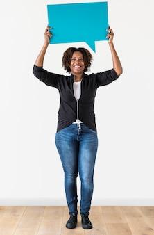A woman holding speech bubble icon