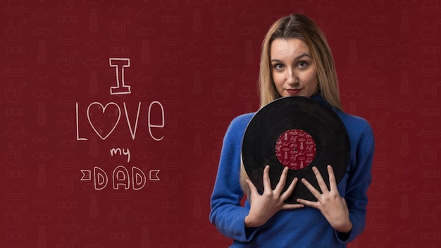 Woman holding vinyl on burgundy background