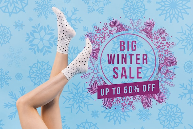 Woman legs with winter sale mock-up