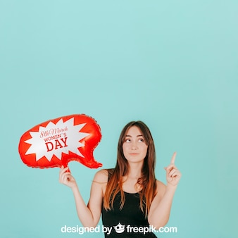 Woman pointing up with speech balloon mockup