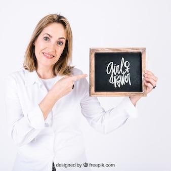 Woman presenting slate