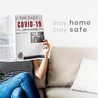 Woman reading coronavirus news from a newspaper