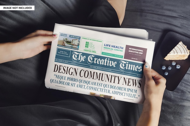 Woman relaxes and reads a newspaper mockup