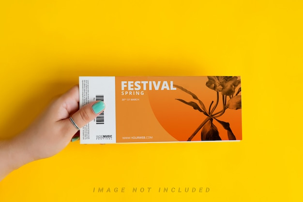 Woman's hands are holding mockup ticket