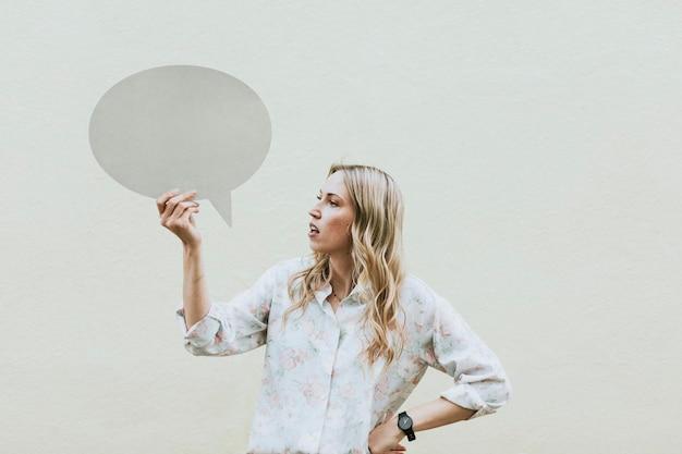 Woman showing a blank speech bubble