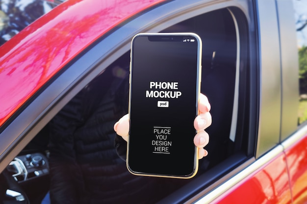 Woman showing smartphone out window car mockup