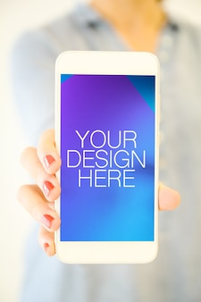 Woman showing smartphone screen mockup