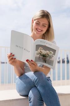 Woman on street reading book