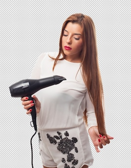 Woman using a dryer