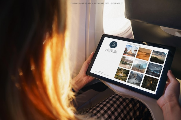 Woman using tablet on aircraft cabin mockup