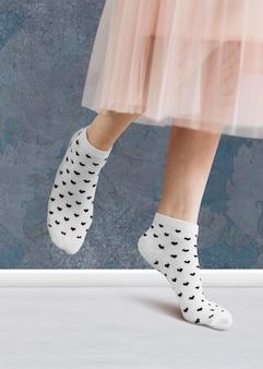 Woman wearing a skirt in white socks