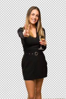 Woman with champagne celebrating new year 2019 happy and counting two with fingers