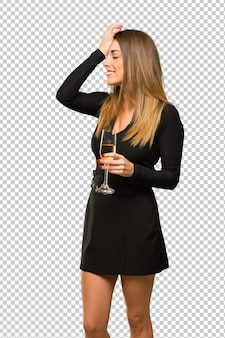 Woman with champagne celebrating new year 2019 has just realized something