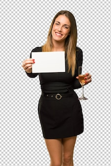 Woman with champagne celebrating new year 2019 holding an empty white placard for insert a concept