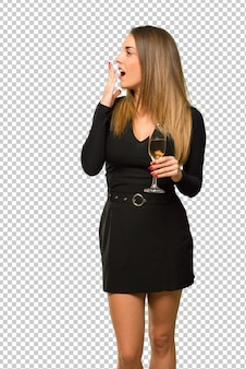 Woman with champagne celebrating new year 2019 yawning and covering mouth with hand