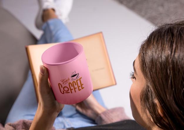 Woman with coffee mug reading