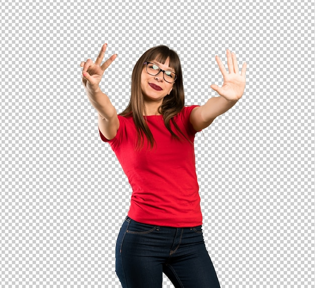 Woman with glasses counting seven with fingers