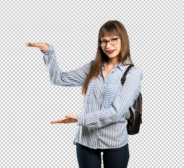 Woman with glasses holding copyspace to insert an ad
