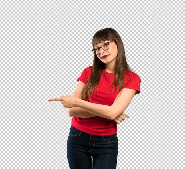 Woman with glasses pointing finger to the side