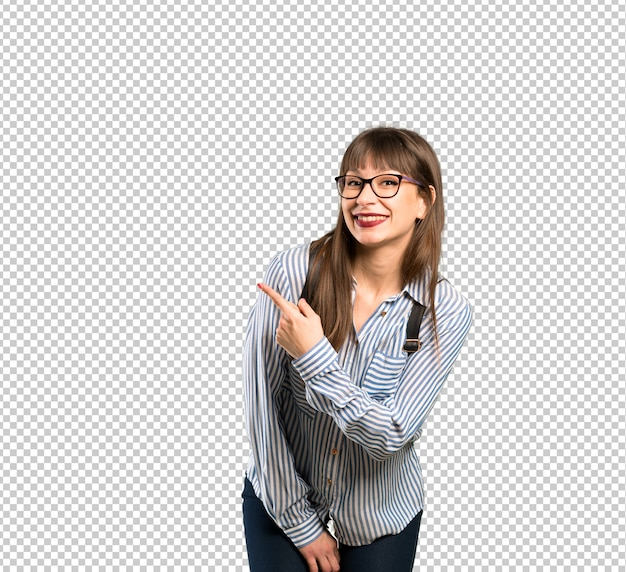 Woman with glasses pointing to the side to present a product