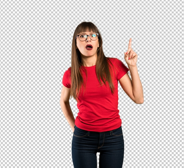 Woman with glasses pointing up and surprised