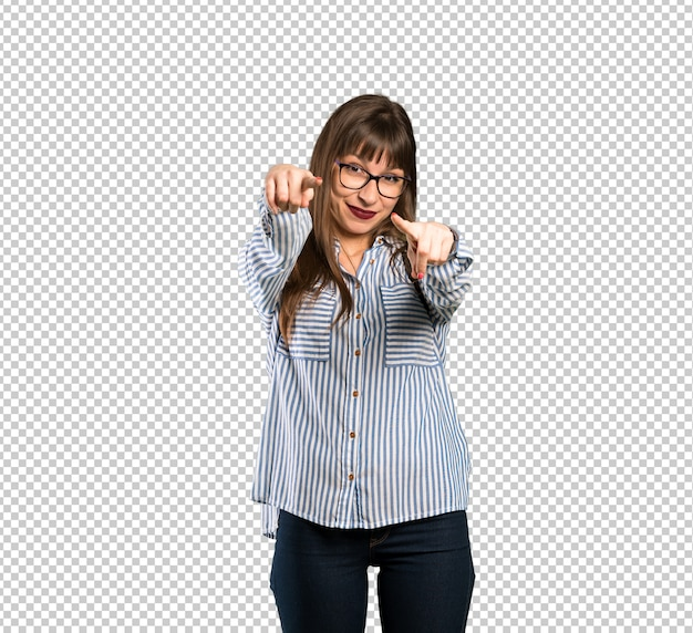 Woman with glasses points finger at you while smiling