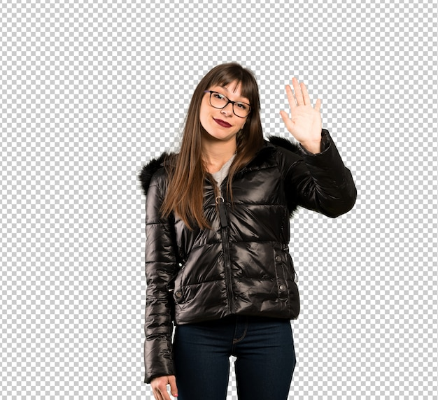Woman with glasses saluting with hand with happy expression
