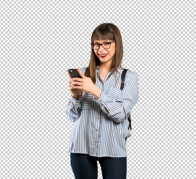 Woman with glasses sending a message with the mobile