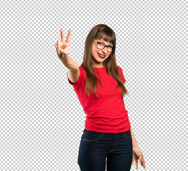 Woman with glasses smiling and showing victory sign