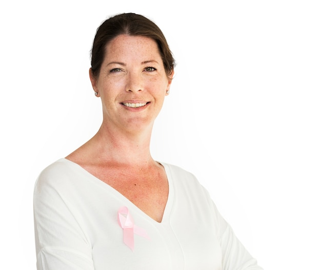 Woman with pink ribbon for breast cancer awareness charity studio portrait