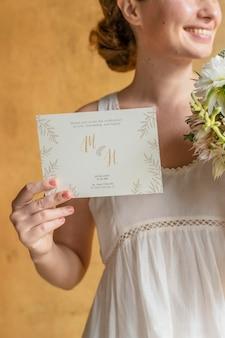 Woman with a wedding invitation card mockup