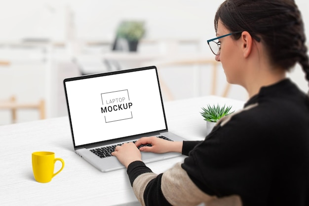 Woman work on laptop computer mockup
