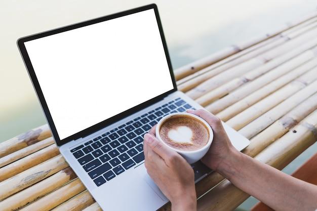 Women hand holding a hot espresso mug