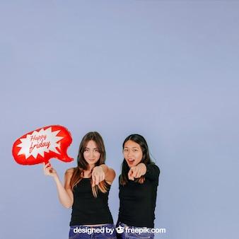 Women pointing forward with speech balloon mockup