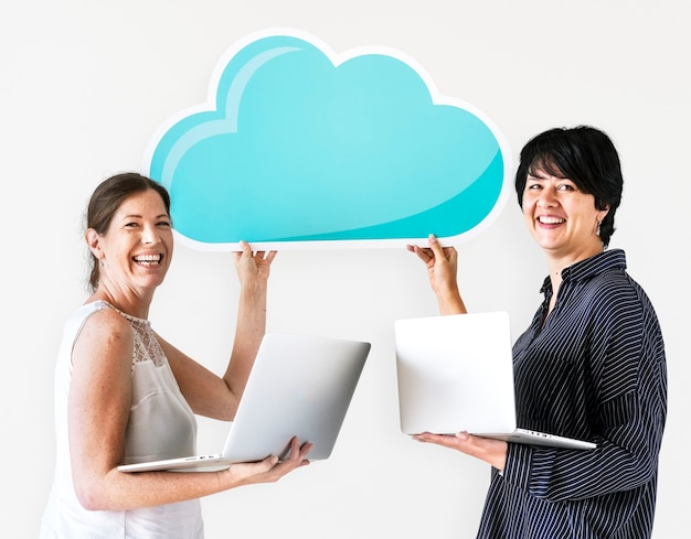 Women using computers with cloud network