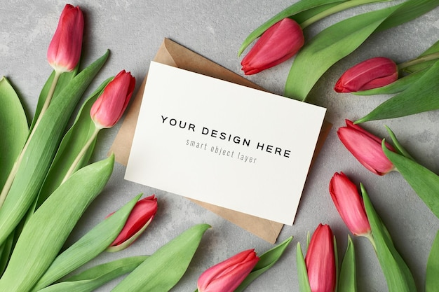 Womens day greeting card mockup with envelope and red tulip flowers