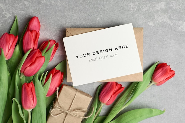 Womens day greeting card mockup with gift box and red tulip flowers