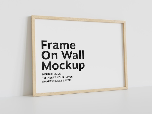 Wood frame leaning on white wall mockup