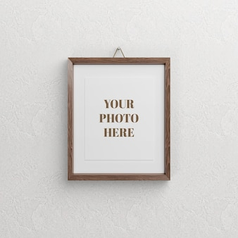 Wood photo frame mockup design isolated on wall
