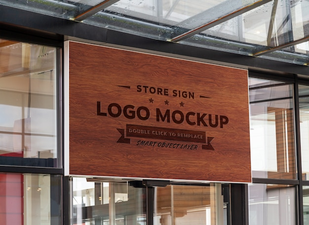 Wood sign on shop front window mockup