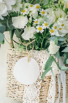 Wooden basket of white flowers