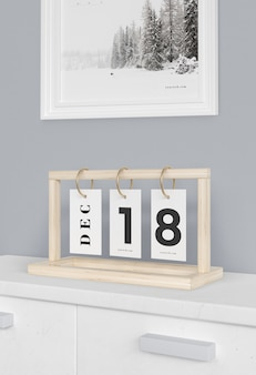 Wooden board with calendar numbers in tags