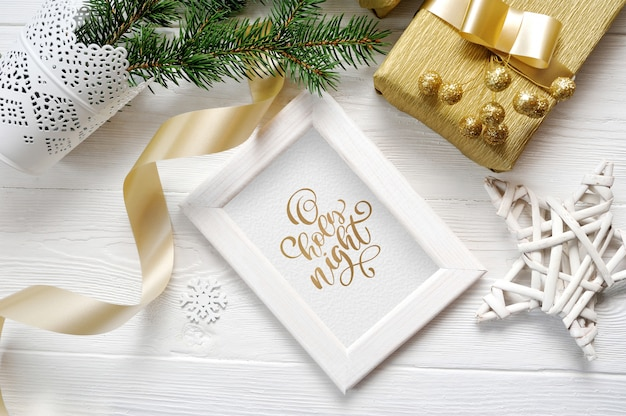 Wooden frame mockup, boxes in craft paper with satin golden ribbon for xmas