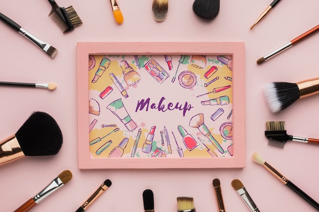 Wooden frame surrounded by makeup brushes